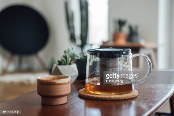 teapot and mug on the coffee table in the living room - 後ろボケ ストックフォトと画像