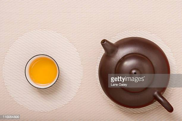 Teapot and Tea Cup on Geometric Place Mat