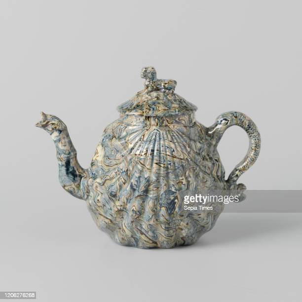 Teapot of hard-fired earthenware, Staffordshire , Teapot of hard-fired earthenware. Both sides are shaped like a shell. The spout has the shape of an...