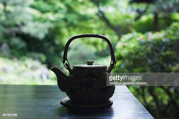 Teapot on table outdoors