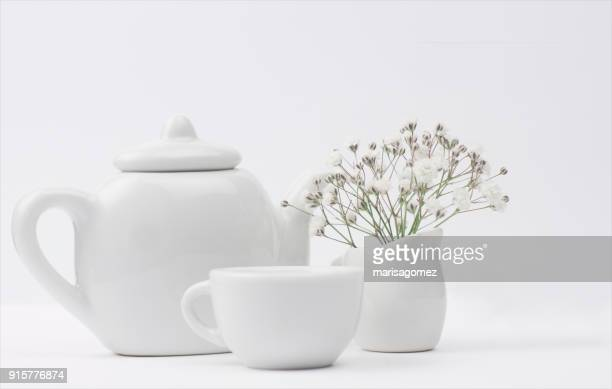 teapot, teacup and milk jug with flowers - ティーポット ストックフォトと画像