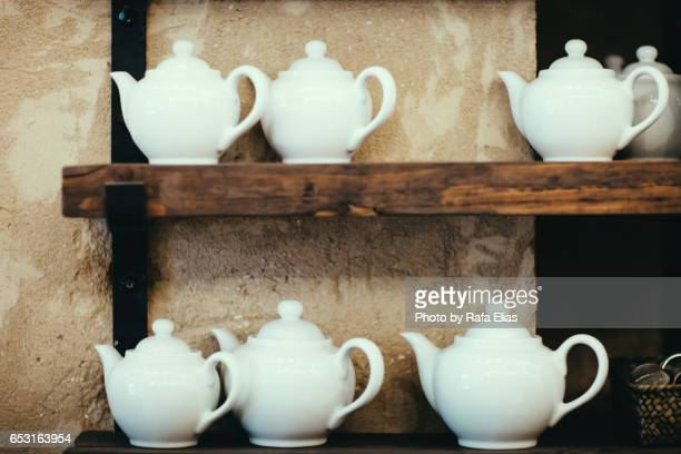teapots on shelving - english teapot stock pictures, royalty-free photos & images