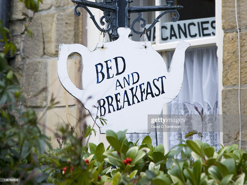 Teapot-shaped sign outside bed and breakfast. : Stock Photo