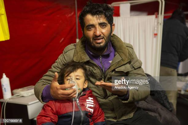 Tear gas affected asylum seekers receive gas inhalation treatment at hospital tent after Greek police as Greek security forces use tear gas to...