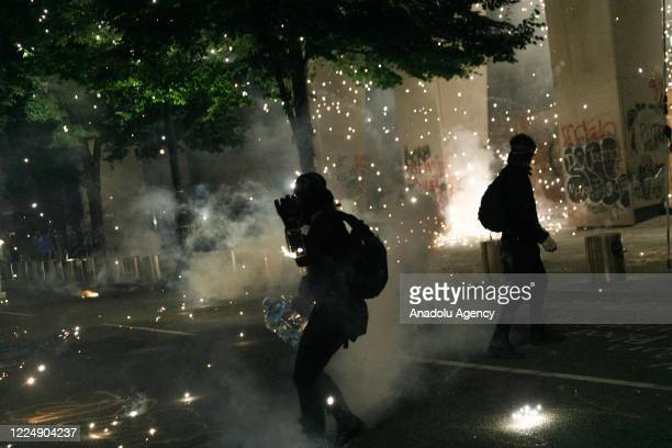 Tear gas and fireworks mix as Black Lives Matter supporters demonstrate in Portland Oregon on July 4 2020 for the thirtyeighth day in a row at...