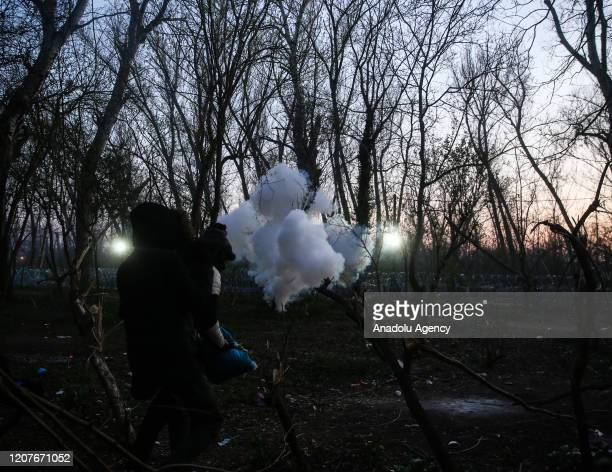 Tear gas and pepper spray affected asylum seekers are seen after Greek border forces interventions to disperse them in Edirne, Turkey on March 19,...