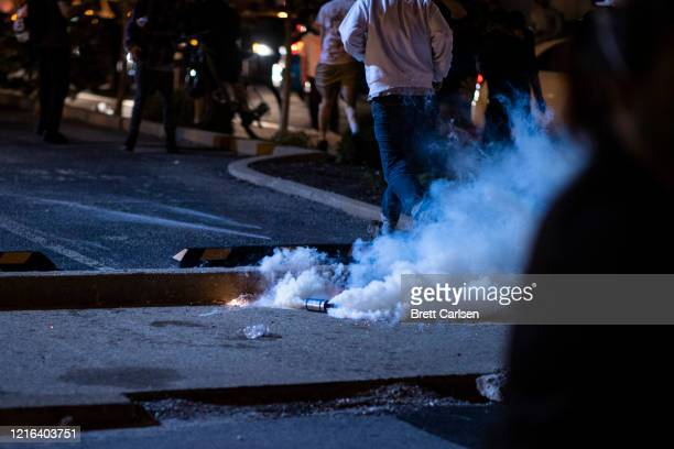 A tear gas canister erupts as protesters disperse on May 30 2020 in Louisville Kentucky Protests have erupted after recent policerelated incidents...
