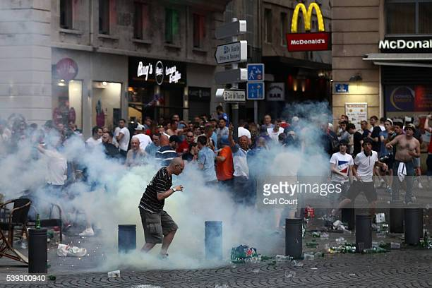 A tear gas canister explodes next to a football fan as England fans clash with police in Marseille on June 10 2016 in Marseille France Football fans...