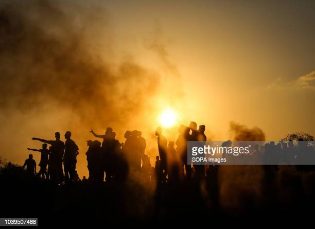 Tear gas canisters are fired by Israeli troops towards Palestinian demonstrators during a protest calling for lifting the Israeli blockade on Gaza on...