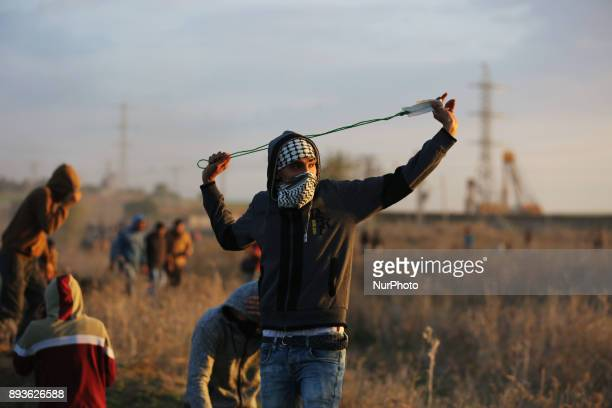 Tear gas canisters are fired by Israeli troops towards Palestinian demonstrators during clashes at a protest against US President Donald Trump's...