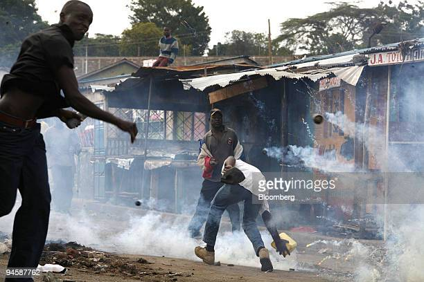 Tear gas canisters explode around protestors during street riots in the suburbs of Mathare in Nairobi Kenya on Thursday Jan 17 2008 Kenya's...
