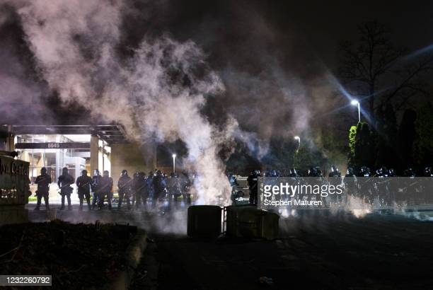 Tear gas fills the air as people confront police outside the Brooklyn Center police headquarters on April 11, 2021 in Brooklyn Center, Minnesota....