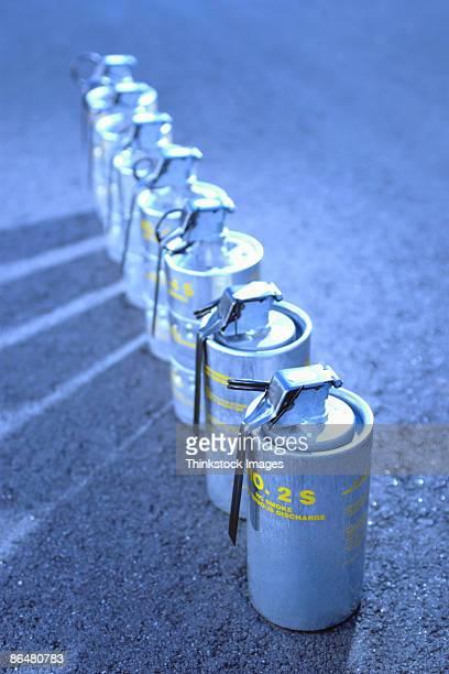 tear gas grenades in a row - tear gas fotografías e imágenes de stock