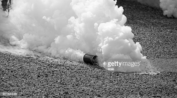 Tear gas in motion in black and white