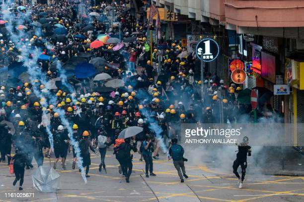 Tear gas is fired by police at protesters in Sham Shui Po in Hong Kong on August 11 in the latest opposition to a planned extradition law that was...