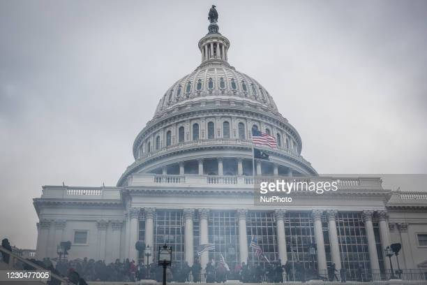 Tear gas outside the U.S Capitol, on January 06, 2021 in Washington, DC. The protesters stormed the historic building, breaking windows and clashing...