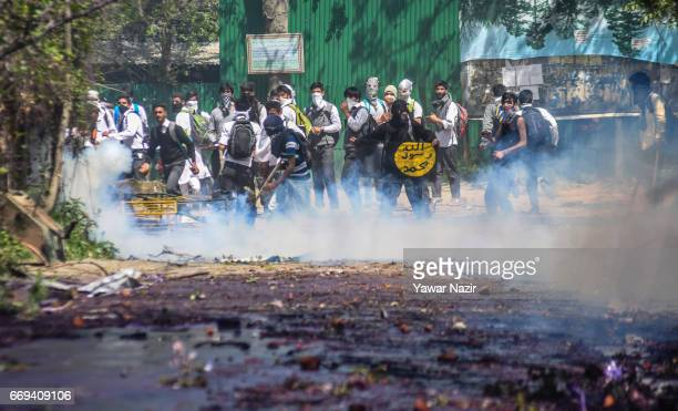 Tear gassed Kashmiri students throw stones at Indian government forces after they tried to march in the city's main commercial hub to protest the...