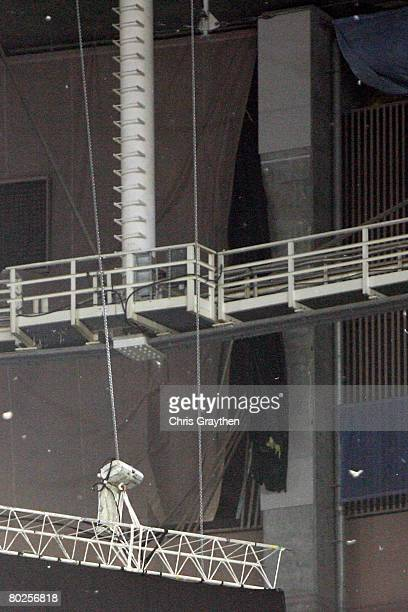 A tear in the ceiling of the Georgia Dome is visible after severe weather passed over the building during the SEC Men's Basketball Tournament on...
