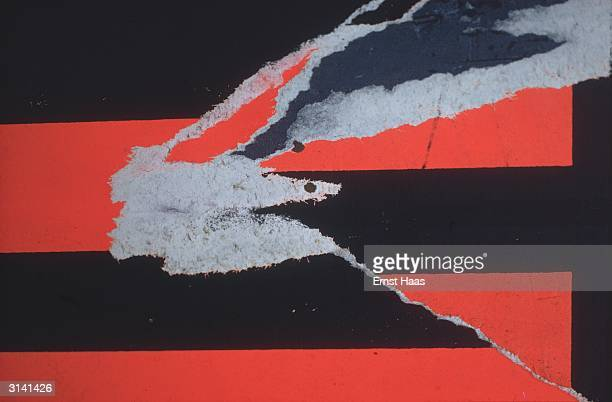 A tear in the vivid red and black pattern of a poster in New York City Colour Photography book
