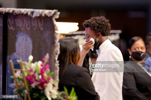 Tear is wiped from the cheek of Khalil Bryant as he views the remains of his 16-year-old sister Ma'Khia Bryant during her visitation at First Church...