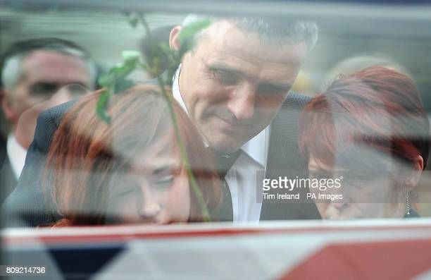 A tear rolls down the cheek of Philip Mead the father of Royal Marine Marine Nigel Dean Mead killed in Afghanistan as he watches his son's body being...