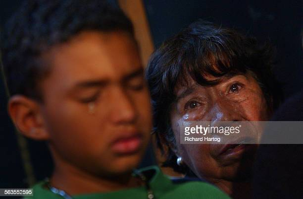A tear rolls down the face of Michael Chambers left as he and his grandmother Virginia Rojas listen during a press conference about the Independence...