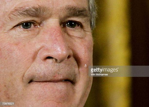 A tear runs down the cheek of US President George W Bush during a posthumous presentation of the Congressional Medal of Honor for Cpl Jason Dunham...