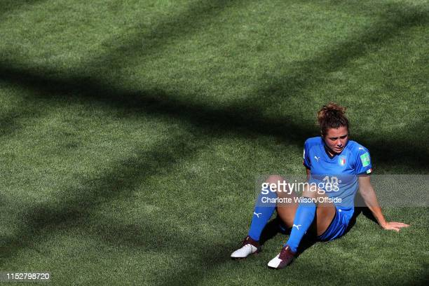 A tearful Christiana Girelli of Italy sits on the pitch after Italy are knocked out of the World Cup after the 2019 FIFA Women's World Cup France...