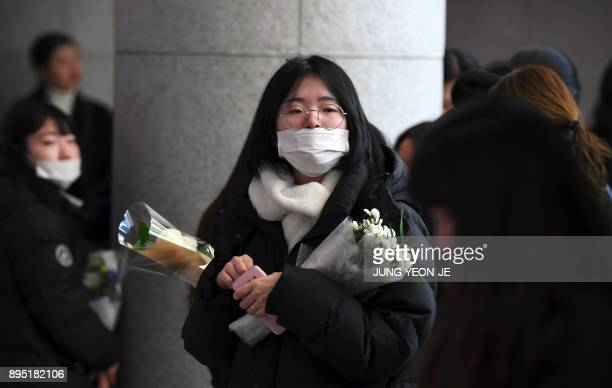 Tearful fans gather to visit the mourning altar for Kim JongHyun a 27yearold lead singer of the massively popular Kpop boyband SHINee at a hospital...