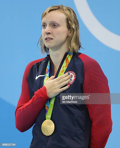 A tearful Katie Ledecky of United States is seen on the podium during her National anthem after the Women's 800m Freestyle final on Day 7 of the Rio...