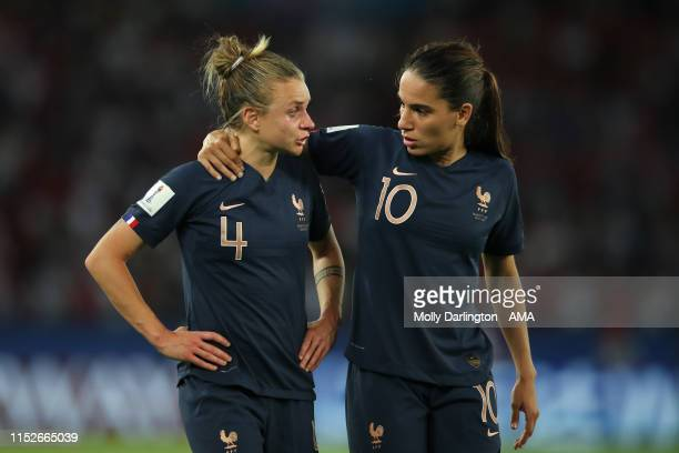 A tearful Marion Torrent of France is consoled by Amel Majri of France during the 2019 FIFA Women's World Cup France Quarter Final match between...
