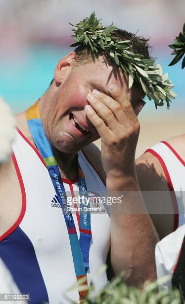 A tearful Matthew Pinsent of Great Britain stands on the podium during the medal ceremony for the men's four event on August 21 2004 during the...