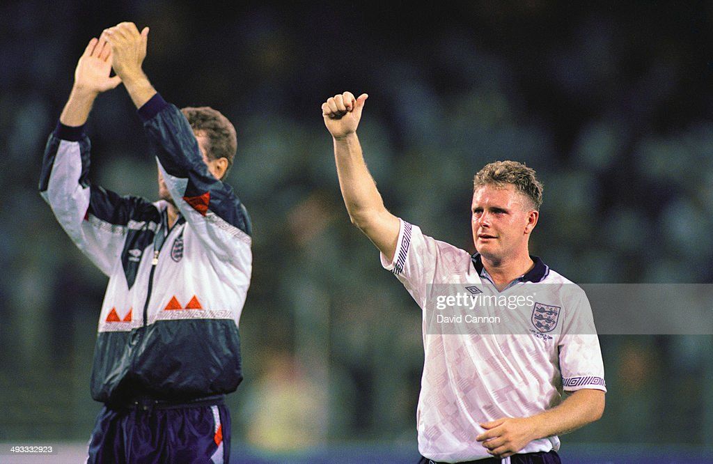 A tearful Paul Gascoigne (r) and team mate Terry Butcher salute the fans after loosing the FIFA World Cup Finals 1990 Semi- Final match between West Germany and England at the Stadio Delle Alpi on July 4, 1990 in Turin, Italy. The match ended in a 1-1 draw after extra time, with West Germany winning 4-3 in the penalty shoot out.