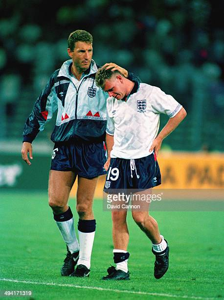Tearful Paul Gascoigne is consoled by team mate Terry Butcher after loosing the FIFA World Cup Finals 1990 Semi- Final match between West Germany and...