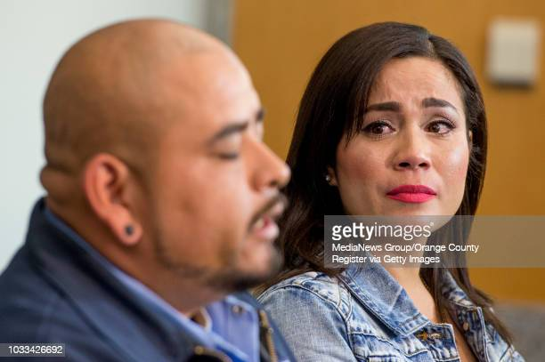 A tearful Tina Marie Costa right listens brother Andrew Trejo left speaks to the media during a press conference to discuss how through their DNA...