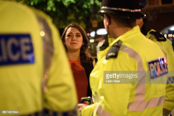 A tearful woman thanks police officers for all of their work following an evening vigil outside the Town Hall on May 23 2017 in Manchester England An...