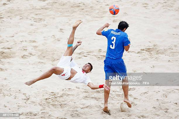 Tearii Labaste of Tahiti attempts a scissor kick shot on goal in front of Matteo Marrucci of Italy during the FIFA Beach Soccer World Cup semi final...
