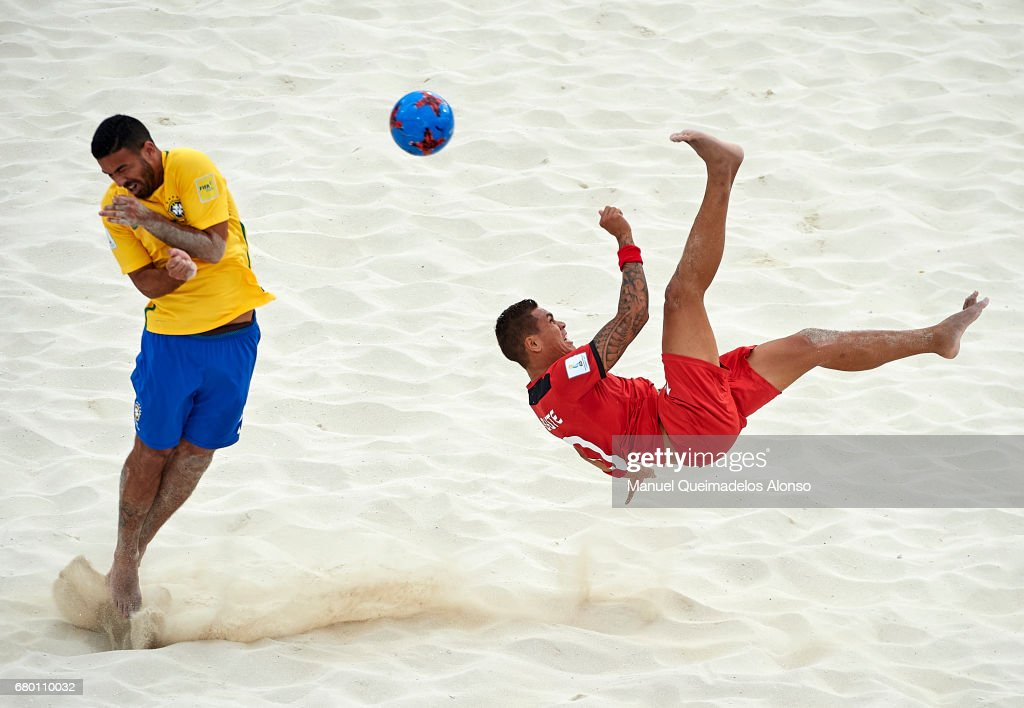 Tearii Labaste (R) of Tahiti attempts a scissor kick shot on goal in front Daniel Nogueira of Brazil during the FIFA Beach Soccer World Cup Bahamas 2017 final match between Tahiti and Brazil at National Beach Soccer Arena at Malcolm Park on May 7, 2017 in Nassau, Bahamas.