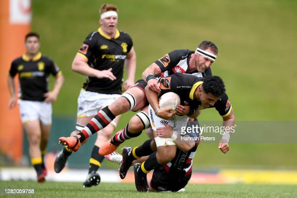 Teariki Ben-Nicholas of Wellington is tackled by Kieran Read of Counties Manukau during the round 7 Mitre 10 Cup match between Counties Manukau and...