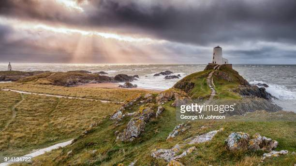 tearing the sky over ynys - wales stock pictures, royalty-free photos & images