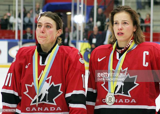 Tears are in the eyes of Canadian captain Cassie Campbell and Cheryl Pounder following the loss to USA in the IIHF Womens World Championship final...