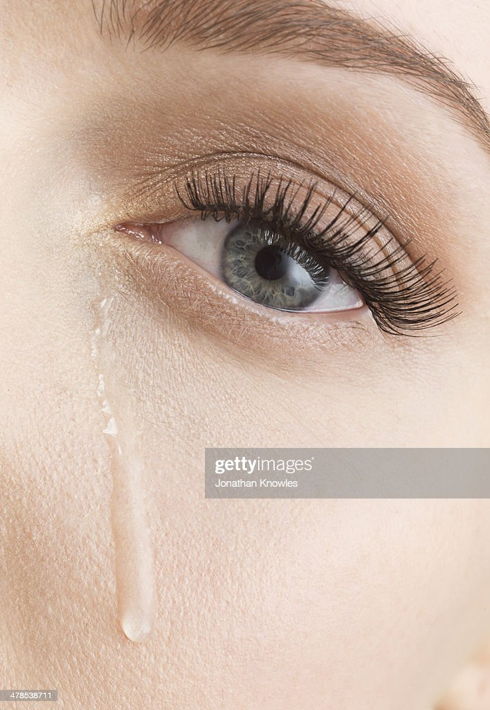 Tears down female face, close up : Stock Photo