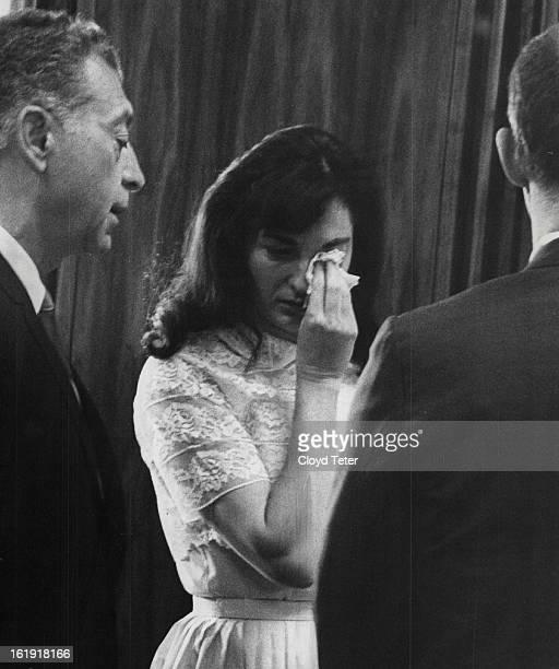MAY 25 1967 Tears Leave No Doubt of Verdict Defense attorney C J Berardini left attempts to comfort Mrs Grace Susan Douglas Thursday in Denver...