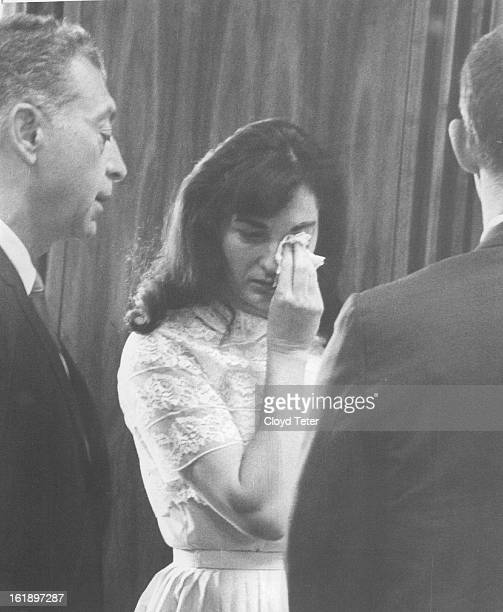 MAY 25 1967 Tears Leave No Doubts of Verdict Defense attorney C J Berardini left attempts to comfort Mrs Grace Susan Douglas Thursday in Denver...