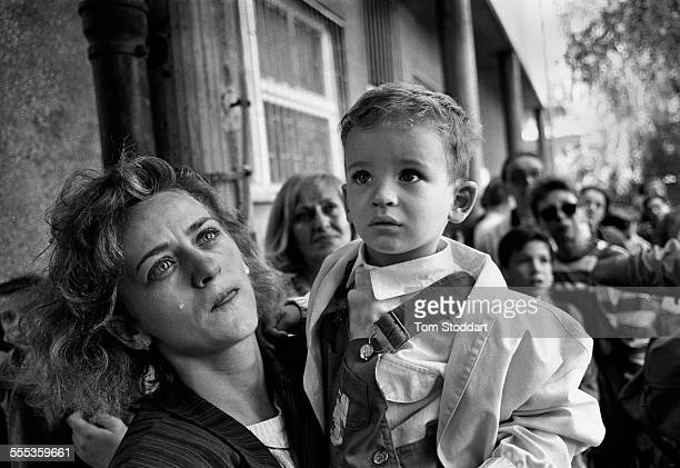 Tears of anguish for a mother as she prepares to send her confused child out of Sarajevo on a bus promised safe passage by the Serb forces during the...