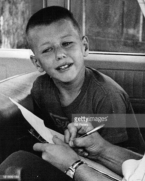 JUN 15 1965 Tears Over 'Unloaded' Gun Elmo Ardell Night Jr son of Mr and Mrs Elmo A Night 2921 Umatilla St tearfully tells a policeman the story of a...