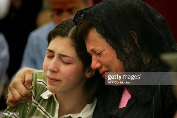 Tears roll down the cheeks of relatives comforting each other during a memorial service for 16yearold American Daniel Wultz 15 May 2006 at a...