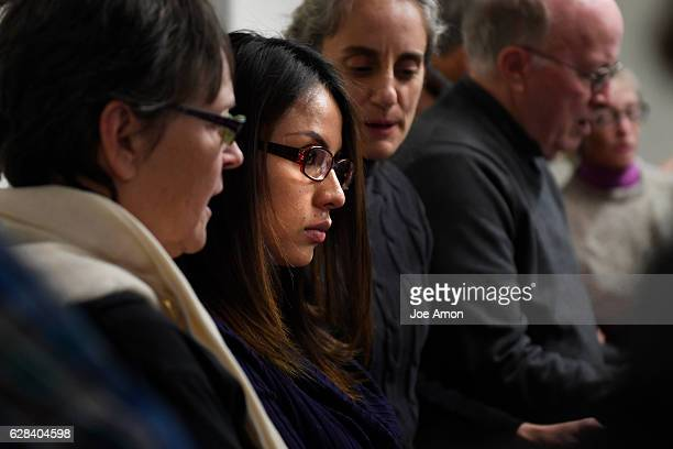 Tears run down Ingrid Encalada Latorre's cheeks during a heart felt song to welcome her from the members of the community as she announces her claim...