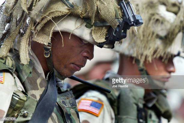 Tears run off the face of a United States Army soldier from the 1st battalion 22nd Infantry Regiment of the 4th Infantry Division during a memorial...