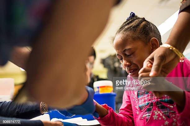Tears stream down the face of Morgan Walker age 5 of Flint as she gets her finger pricked for a lead screening on January 26 2016 at Eisenhower...